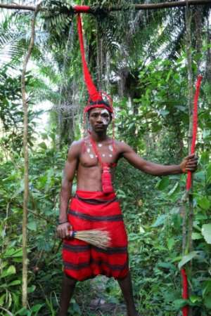 Alie Koroma of the Poro secret society in Matru stands guard at a forest site where initiation ceremonies are taking place.  By LYNN ROSSI (AFP)