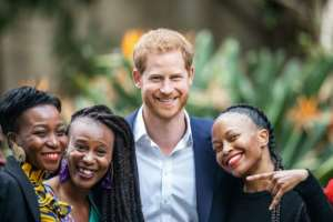 All smiles: Prince Harry at the British High Commissioner's residency.  By Michele Spatari (AFP)