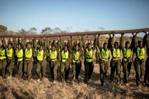 All the Akashinga rangers have overcome adversity in their past, having survived abuse or great hardship.  By GIANLUIGI GUERCIA (AFP)