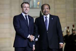 Allies: French President Emmanuel Macron welcomes Cameroonian President Paul Biya at the Elysee Palace.  By LUDOVIC MARIN (AFP)