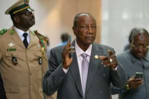 Alpha Conde, centre, became Guinea's first democratically-elected president in 2010 - today, critics say he has taken the well-worn path of authoritarianism.  By Michael TEWELDE (AFP)