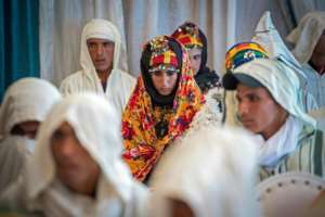 Among those waiting to wed, some looked nervous, while other couples exchanged excited glances.  By FADEL SENNA (AFP)