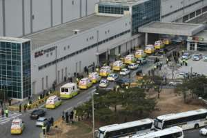 Ambulances are seen at Seoul Gimpo airport waiting for a plane carrying South Korean citizens repatriated from the Chinese city of Wuhan.  By Jung Yeon-je (AFP)