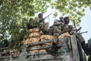 Amhara special forces troops, sitting on top of a truck in Alamata.  By EDUARDO SOTERAS (AFP)