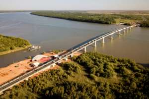An aerial view of the new concrete bridge which crosses the River Gambia.  By Emilie IOB (AFP)