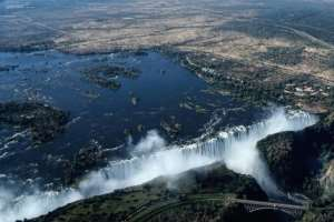 An aerial view of the Victoria Falls on the Zambezi River at the border between Zambia and Zimbabwe. Tourism accounts for around 10 percent of Zimbabwe's GDP..  By Zinyange AUNTONY (AFP)