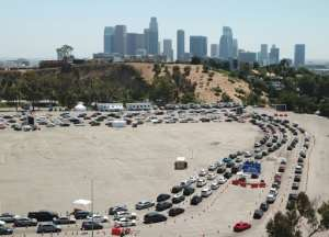 An aerial view shows a long line of cars at a COVID-19 testing site at Dodgers Stadium in Los Angeles, California, on July 15, 2020.  By Robyn Beck (AFP)