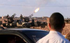An anti-aircraft gun fires during the funeral of a commander of the self-proclaimed Libyan National Army loyal to strongman Khalifa Haftar, in the eastern city of Benghazi on November 1.  By Abdullah DOMA (AFP/File)