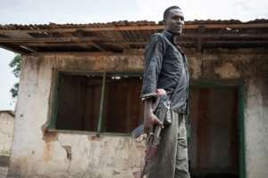 An armed bodyguard patrols the premises of the leader of an armed group in the volatile PK5 district of the capital Bangui..  By FLORENT VERGNES (AFP/File)
