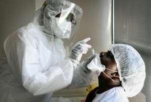 An elderly home worker is tested for novel coronavirus near Paris.  By ALAIN JOCARD (AFP)