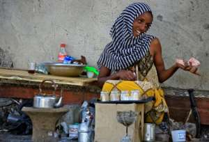 An Ethiopian refugee who fled the fighting in Tigray sells tea in Village 8 in Gedaref State, eastern Sudan.  By ASHRAF SHAZLY (AFP)