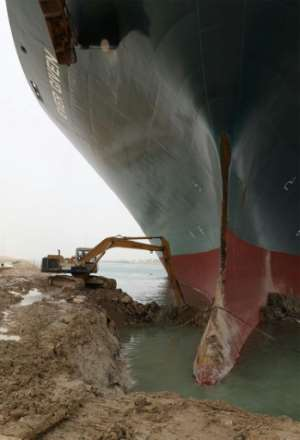 An excavator is used to dig out the Ever Given, a 400-metre- (1,300-foot) long vessel lodged across Egypt's Suez Canal.  By - (Suez CANAL/AFP)