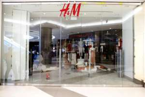 An H&M store in Johannesburg's posh Sandton City shopping mall was closed after EFF members stormed inside.  By WIKUS DE WET (AFP)
