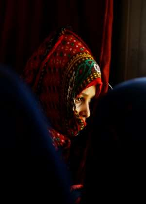 An illegal migrant from Eritrea sits on a bus at the al-Laffa border crossing in Sudan's eastern Kassala state on the Eritrea-Sudan border as she is deported from Sudan back to her homeland on May 2, 2017