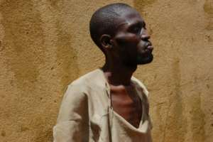 An inmate at Kenema jail takes his turn in the prison courtyard.  By Saidu BAH (AFP)