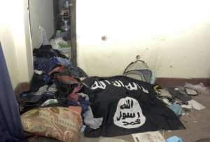An Islamic State group flag at a location where suspected extremists were killed in a 2016 gun battle with police in Dhaka, Bangladesh