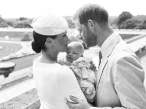 An official christening photo released by Prince Harry and his wife Meghan, holding their baby son, Archie at Windsor Castle.  By Chris ALLERTON (SUSSEXROYAL/AFP/File)