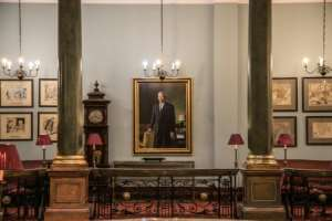An oil painting of former South African president and anti-apartheid icon Nelson Mandela is featured on the first floor of the Rand Club.  By MARCO LONGARI (AFP)