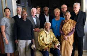 Annan was a member of 'The Elders' group set up in 2007 by Nelson Mandela (seated) along with the likes of Desmond Tutu and former US president Jimmy Carter.  By Jeff Moore (The Elders/AFP/File)
