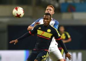 Andres Cifuentes (front) of Colombia and Josh Sargent (R) of USA vie for a ball during their group stage match which Colombia won 3-1