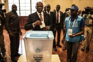 Angola's Jose Eduardo dos Santos, shown here voting in last year's election won by Joao Lourenco, says he wants to be remembered for his dignified exit from the office he held since 1979.  By MARCO LONGARI (AFP)