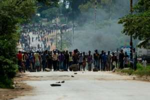 Angry protesters barricaded the main route to Zimbabwe's capital Harare from Epworth township in protest at the steep rise in fuel prices.  By Jekesai NJIKIZANA (AFP)