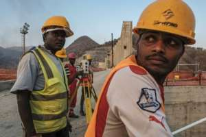 As workers toil to finish the project, Ethiopian negotiators remain locked in talks over how the dam will affect downstream neighbours, principally Egypt.  By EDUARDO SOTERAS (AFP)