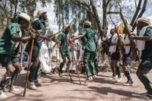 As rifle-toting actors danced around chanting actresses, an audience cheered when the troupe denounced the Tigray People's Liberation Front as a band of 'traitors'.  By EDUARDO SOTERAS (AFP)