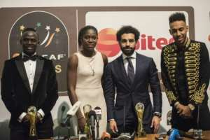 Asisat Oshoala was voted the women's African footballer of the year for a third time in 2017 and shared the stage with the top three in the men's category: winner Mohamed Salah, Sadio Mane and Pierre-Emerick Aubameyang.  By CRISTINA ALDEHUELA (AFP/File)