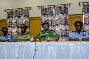 Army chief Constantino Chiwenga (centre, right) on Monday warned of military intervention if the purges continued