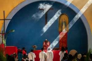 Around 400 faithful celebrated Palm Sunday at Lady of Grace Parish Catholic Church.  By Zinyange AUNTONY (AFP)