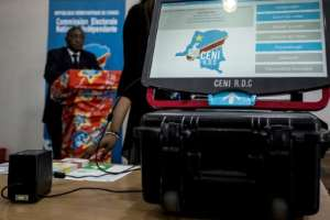 Around three-quarters of the touch-screen voting terminals earmarked for Kinshasa were damaged in the fire.  By John WESSELS (AFP/File)