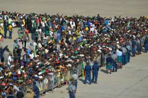 Around two thousand supporters, family members and government officials were on the tarmac at Harare airport to welcome Mugabe's remains.  By TONY KARUMBA (AFP)