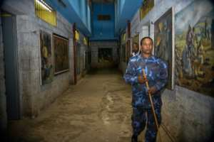 Artwork depicting scenes from Ethiopian history line a corridor at the torture facility.  By MICHAEL TEWELDE (AFP)