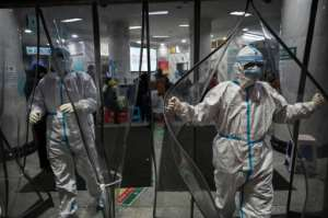 At the epicentre of the deadly epidemic, China's Wuhan city, hospitals are overwhelmed.  By Hector RETAMAL (AFP)