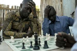 At the Munuki Chess Club in South Sudan's capital Juba, people from different tribes and backgrounds have been brought together over their love of the game. By SIMON MAINA (AFP)