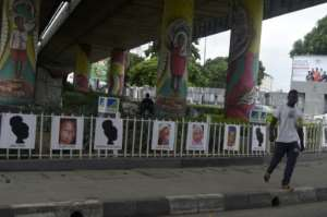 At a big traffic junction in the centre of the economic capital Lagos, drivers no longer pay attention to the girls' pictures hung along the railings. By PIUS UTOMI EKPEI (AFP)