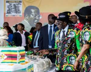 At his 93rd birthday celebrations in 2017, Mugabe struggled to walk unassisted and sat impassively in his seat through his birthday proceedings.  By Jekesai NJIKIZANA (AFP/File)