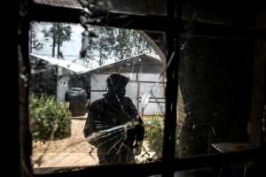 Attacked: The bullet-riddled window of an Ebola treatment centre in Butembo, which was assaulted by suspected Mai-Mai militiamen in March. A policeman was killed and a healthworker wounded.  By JOHN WESSELS (AFP)