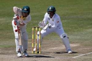 Australian batsman David Warner defends a delivery as South African wicketkeeper Quinton de Kock looks on.  By MARCO LONGARI (AFP/File)