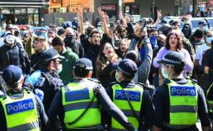 Australian police arrested dozens at an anti-lockdown rally in Melbourne on Sunday after crowds defied stay-at-home orders.  By William WEST (AFP)