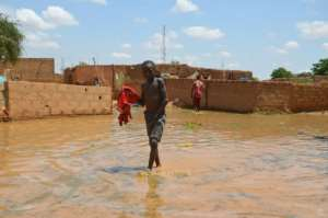 Authorities trigged a 'red alert' as water rose to 6.38 metres (21 feet) in Niamey.  By BOUREIMA HAMA (AFP)
