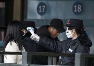 Authorities are conducting temperature checks on people across China as they return to work following the Lunar New Year holiday.  By NOEL CELIS (AFP)