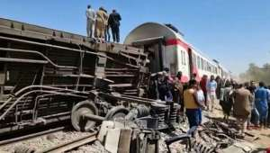 Axles, springs and twisted metal protrude from one of the railway carriages overturned in the collision in southern Egypt.  By - (AFP)