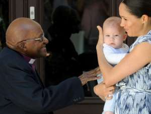 Baby face: Archie captured the headlines on Wednesday when Harry and his wife Meghan introduced him to South Africa's anti-apartheid campaigner Archbishop Desmond Tutu and his wife Leah.  By HENK KRUGER (POOL/AFP)