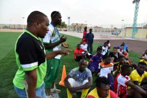 Bachir Ama, left, president of the Nassara Agadez football club, has hired four Nigerians and four Ivorians stranded while waiting to reach north Africa or Europe