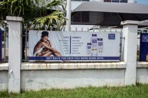 Back to nature: A billboard advertises products to restore natural skin colour on Spintex Road in Accra, the Ghanaian capital.  By CRISTINA ALDEHUELA (AFP)