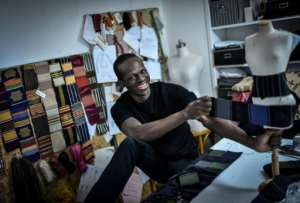 Back to his roots: Fashion designer Imane Ayissi is on a mission to use indigenous African materials in elite Paris haute couture.  By STEPHANE DE SAKUTIN (AFP)