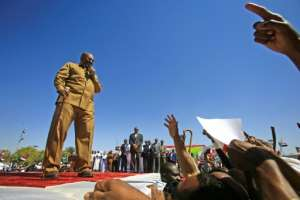 Bashir was known for his populist touch and addressed crowds in colloquial Sudanese Arabic.  By ASHRAF SHAZLY (AFP/File)
