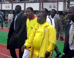 Benin's former Football Federation president Anjorin Moucharafou (C), pictured 2007, was